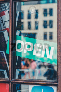 open sign in store entrance - open sign in shop window -