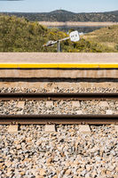 Section of the Extremadura train track of an abandoned station next to the river Tagus, near Garrovillas de Alconetar