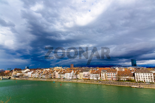 Basel architecture along Rhine River and storm clouds in Basel, Switzerland.