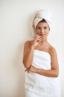 Smiling happy healthy woman wrapped in a towel