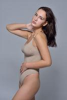 Beautiful woman in pastel underwear.