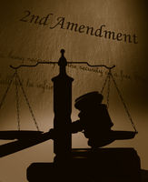 Second Amendment and gavel with scales