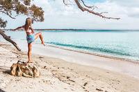 Wioman exercising on beach