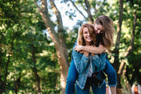 Beautiful women having fun in the park. Friends and summer concept.