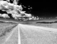 Dramatic black and white country road in Montana