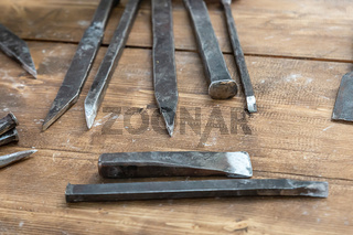 pattern of iron and black bits, old tool for cutting wood patterns, rustic design