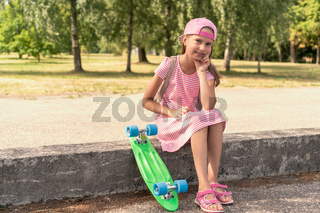 Lovely girl with a penny board