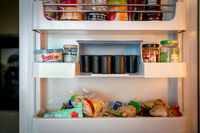 fridge of a photographer with analogue film reels