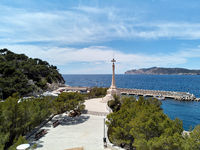 View to the religious monument Cross located in Santa Ponsa port, Mallorca, Spain