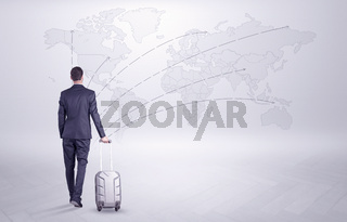 Businessman planning his trip over the world