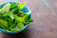Fresh mint leaves in the ceramic bowl