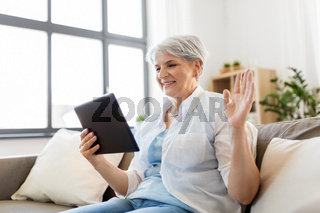 senior woman having video chat on tablet pc