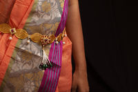 Women wearing traditional golden Traditional Waist Belt or Kamarpatta.