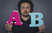 marketing specialist, A / B test error test in online advertising campaigns, test concept A and B. Man with large letters