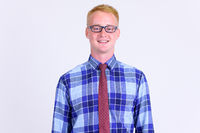 Happy young blonde businessman with eyeglasses smiling