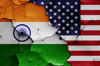 flags of India and USA painted on cracked wall