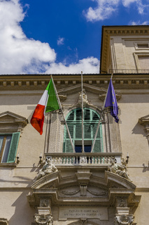 Rome, Italy Quirinal Palace entrance day view with European and Italian flag.