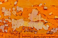 Orange color wall with peeling paint