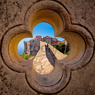 Dubrovnik city walls view through stone carved detail