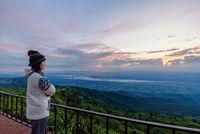 Woman tourist watching the sunrise