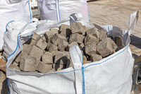 Cobblestones in a big bag on a construction site
