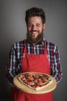 Man holding pizza