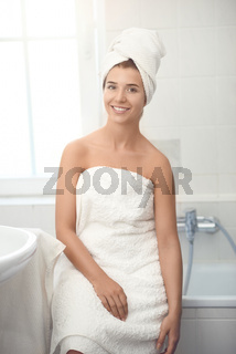 Pretty healthy young girl wrapped in white towels