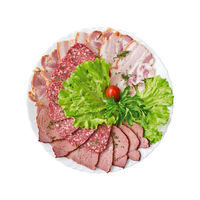 Sliced salami, bacon and ham with vegetables on a plate isolated on white background. Top view