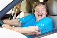 Happy Senior Woman Driving New Car