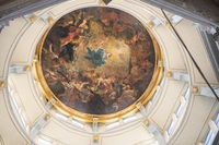 Ornate round ceiling painting in cathedral