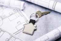House as a key fob and blueprints