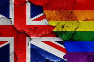 flags of UK and LGBT painted on cracked wall