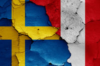 flags of Sweden and Peru painted on cracked wall