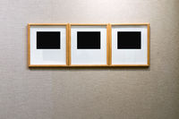 wooden blank frames on old wall
