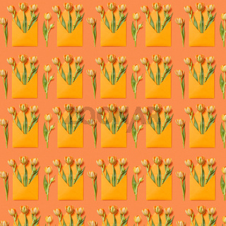 Decorative pattern with gift envelopes of tulips flowers on an orange.