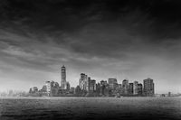 Panoramic view of storm over Lower Manhattan from Ellis Island at dusk, New York City.