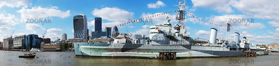 Warship in front of the skyline of the City of London
