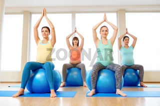 pregnant women sitting on exercise balls in gym