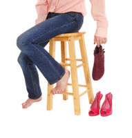 Close up of woman sitting on chair with shoes