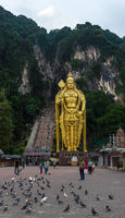 golden Murugan statue stands at the entrance stair way to Batu Caves, Kuala Lumpur, Malaysia.