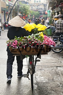 Woman selling flowers on the street in Hanoi, Vietnam