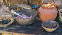 Utensils, handmade dyeing of fabrics and wool in a cauldron with colored dyes in a medieval fair in Spain