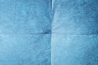 Close-up comfortable blue soft back of the sofa with curly stitching. Modern design