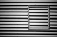 Corrugated iron facade with metal frame