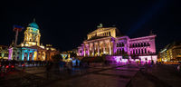 Square Gendarmenmarkt, Konzerthaus and German Church in brightly colored illuminations