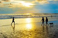 People walking running beach. Bali