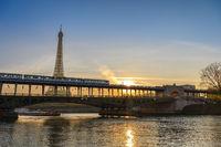 Paris France city skyline sunrise at Eiffel Tower and Seine River with Pont de Bir-Hakeim bridge and