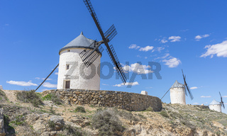 Beautiful summer above the windmills on the field in Spain