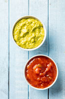 Sauces in bowl. Guacamole and tomato dip
