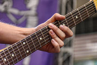 Fingers playing eletric guitar